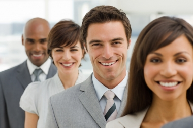 Closeup portrait of happy business group (Neustock  © Neustock; VisaPro.ca. All Rights Reserved.)