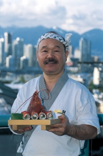 Chef Tojo holding sushi at Tojo&#039;s Restaurant in Vancouver (Ryan, Tom  Ryan, Tom; Tourism BC. All Rights Reserved.)