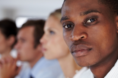 Gros plan sur un jeune homme d'affaires Afro-américain [...] (Arcurs, Yuri © Arcurs, Yuri; VisaPro.ca. Tous droits réservés.)